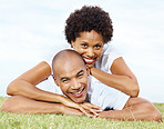 Romantic young couple lying together on lawn