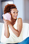 Excited woman holding piggy bank