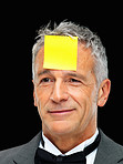 Well dressed man with post-it note on forehead