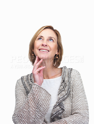 Buy stock photo Pretty mature lady looking up at copyspace on whit