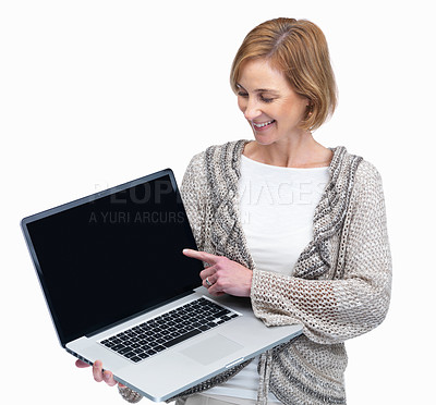 Buy stock photo Happy mature woman pointing to a laptop screen aga