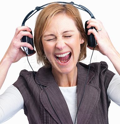 Buy stock photo Mature lady screaming while listening to loud musi
