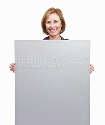 Buy stock photo Pretty mature woman holding blank billboard over w