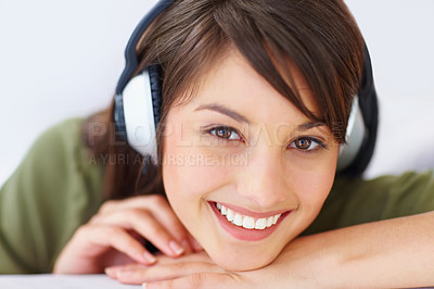 Buy stock photo Closeup of a lovely young female listening to musi