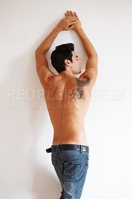 Buy stock photo Rear view of a young male fashion model posing - Copyspace