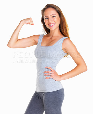 Buy stock photo Pretty woman smiling at you while flexing her bicep against white background