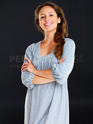 Buy stock photo Smiling woman standing with arms crossed