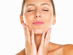 Relaxed woman with hands on face and eyes closed