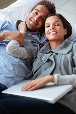 Buy stock photo Young romantic couple relaxing during the day