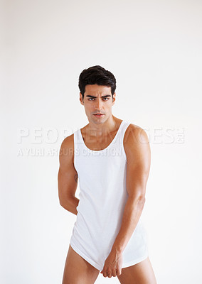 Buy stock photo Portrait of a confident young man posing confidently - Copyspace