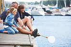 Grandparents with their grandchild at dock
