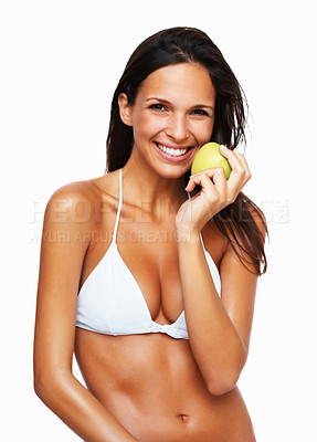 Buy stock photo Sexy woman standing in bikini holding apple