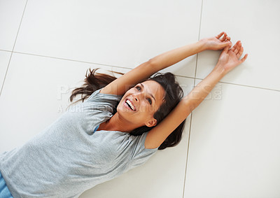 Buy stock photo Smiling pretty woman stretching on the floor