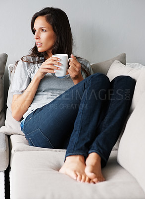 Buy stock photo Pretty woman thinking while holding coffee cup