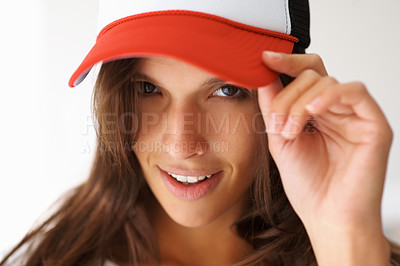 Buy stock photo Sexy woman wearing baseball cap flirting