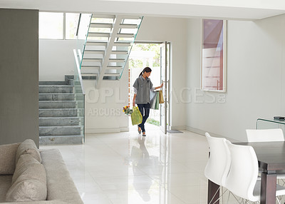 Buy stock photo Pretty woman entering foyer of modern home