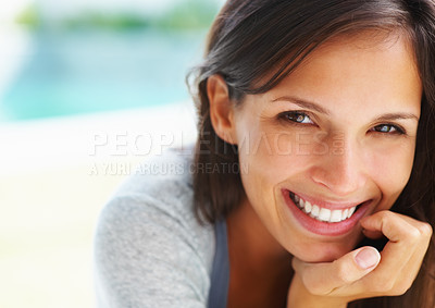 Buy stock photo Pretty woman smiling with chin on hand