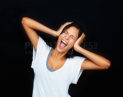 Buy stock photo Woman holding head and screaming against black background