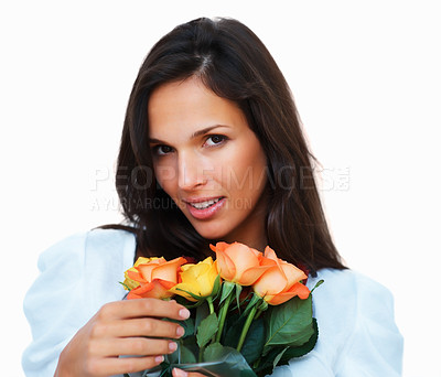 Buy stock photo Pretty woman seductively holding flowers against white background