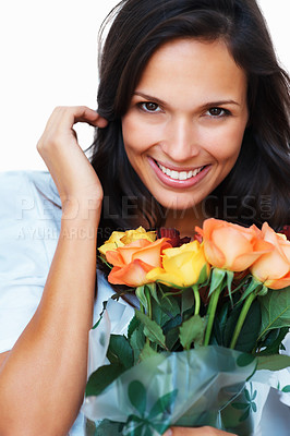 Buy stock photo Bashful woman holding flowers against white background