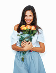 Friendly woman smiling while holding roses