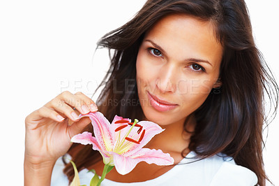 Buy stock photo Portrait of an exceptionally beautiful woman gazing at you while holding a stargazer lily, isolated on white - copyspace