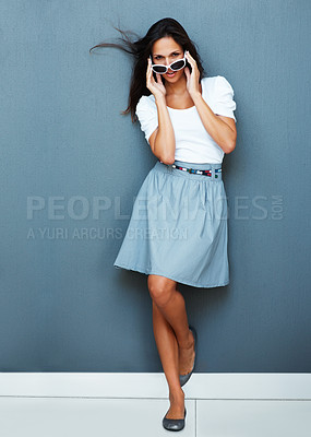 Buy stock photo Full-frame pretty woman putting on sunglasses