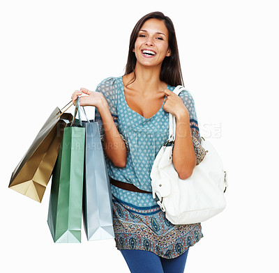 Buy stock photo Woman holding shopping bags against a white background