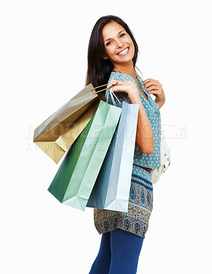 Buy stock photo Side view of woman holding shopping bags against white background