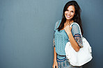 Smiling brunette carrying purse