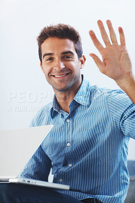 Buy stock photo Portrait of a happy young man sitting behind the glass and using laptop