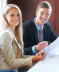 Business people holding document