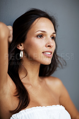 Buy stock photo Portrait of a thoughtful young woman looking away at copyspace