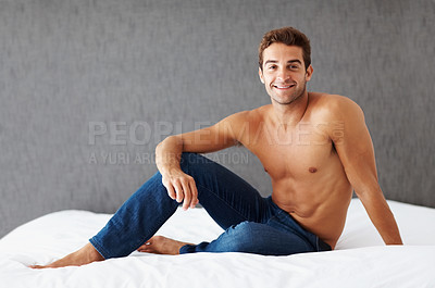 Buy stock photo Portrait of a shirtless young man sitting on a bed at home