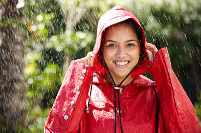 Buy stock photo Beautiful young girl wearing a red raincoat while standing in the rain - Enjoying outdoors