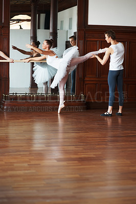 Buy stock photo Portrait of a male ballet trainer training a female ballet dancer in front of a mirror