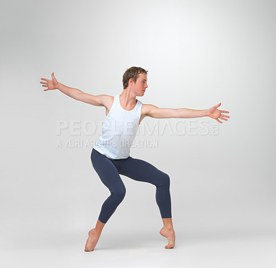 Buy stock photo Full length of a young ballet dancer practicing against white background