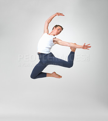 Buy stock photo Full length of a young ballet dancer jumping high against white background