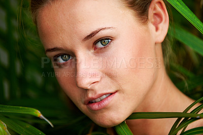 Buy stock photo Closeup portrait of beautiful young woman among leaves in a park - Outdoor
