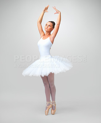 Buy stock photo Full length of a beautiful young ballerina dancing against white background - copyspace