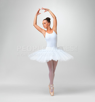 Buy stock photo Full length of a young ballet dancer wearing tutu against white background - copyspace