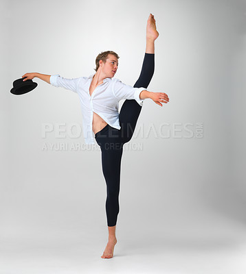 Buy stock photo Full length of a male ballet dancer performing a step with hat in hand against white - copyspace