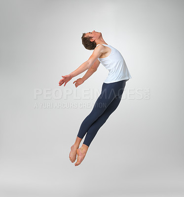 Buy stock photo Full length of a male ballet dancer flying against white background - copyspace