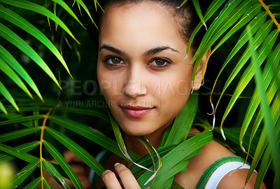 Buy stock photo Closeup portrait of pretty young woman among leaves in a park - Outdoor