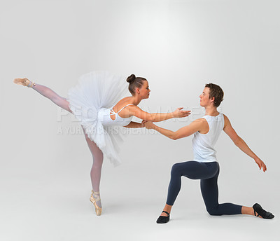 Buy stock photo Full length of two beautiful ballet dancers performing against white background - copyspace