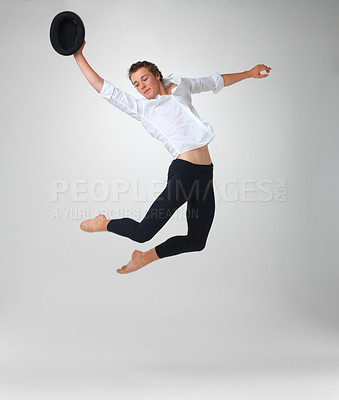 Buy stock photo Full length of a stylish and young ballet dancer jumping against white background - copyspace