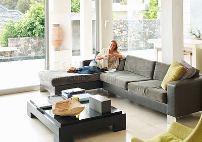 Buy stock photo Mature woman relaxing in a beautiful modern home having a cup coffee