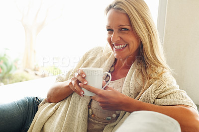 Buy stock photo Closeup portrait of a happy mature woman holding a cup of coffee