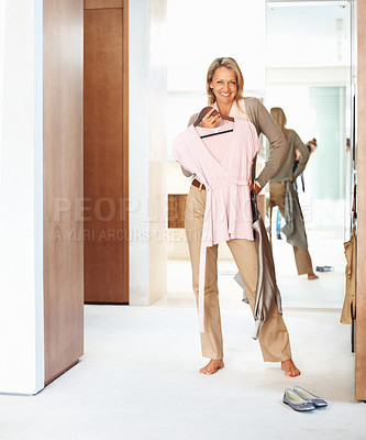 Buy stock photo Portrait of a happy beautiful woman fits on a pink top at home
