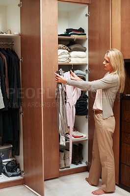 Buy stock photo Beautiful mature woman choosing what to wear